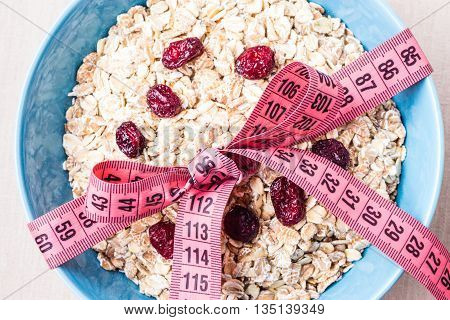 Oatmeal In Blue Bowl With Measuring Tape Around
