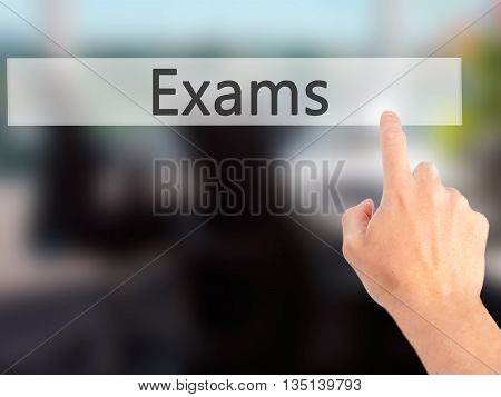 Exams - Hand Pressing A Button On Blurred Background Concept On Visual Screen.
