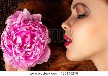 woman profile face with peony on coffee beans