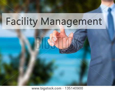 Facility Management - Businessman Hand Pressing Button On Touch Screen Interface.