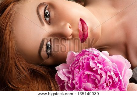 beautiful woman with fashion make-up with pink peony