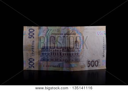 Ukrainian money. New Five hundred hryvnia isolated on black background.