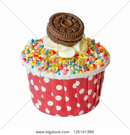 Rainbow cupcakes with vanilla cream and cookies isolated on the white background with clipping path