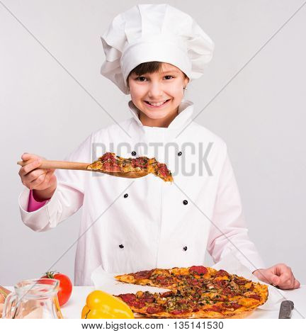 little smiling girl-cook in uniform with big pizza
