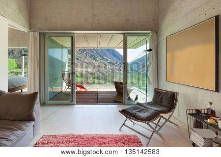 Interior of a modern loft, living with veranda. concrete walls