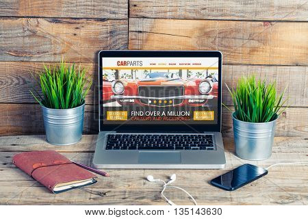 Auto repair on line shop in a laptop screen. Searching for car parts on the internet.