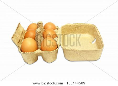 the brown eggs in egg box on white