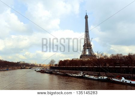 PARIS, FRANCE - February 25, 2016 : Eiffel Tower, nickname La dame de fer, the iron lady, The tower has become the most prominent symbol of  Paris. Paris, France