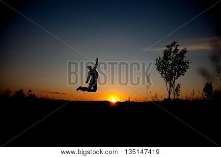 man jumping sunset background. advanced Happy man