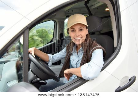 Delivery woman driving van