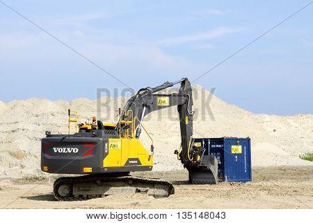 Aarhus, Denmark - June 15, 2016: Volvo excavator. Volvo is a Swedish premium automobile manufacturer established in 1927 in Gothenburg, Sweden