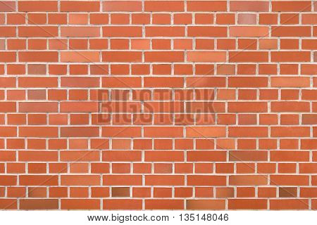 Red brick wall with alternating rows of long and short bricks in close-up