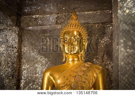 Gold Buddha statue religious temple buddhism of Thailand