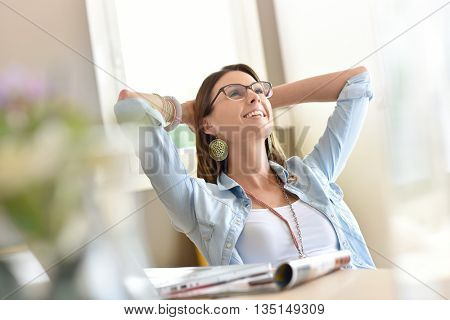 Trendy woman working from home relaxing in chair