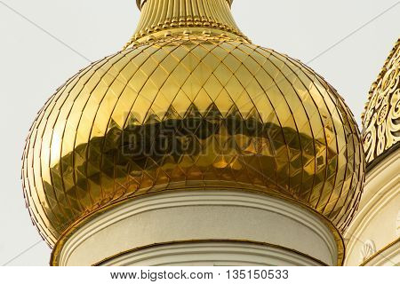 Magnified gilded church dome. Orthodox temple exterior.