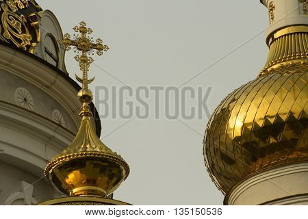 Magnified dome and cross. Orthodox temple exterior.