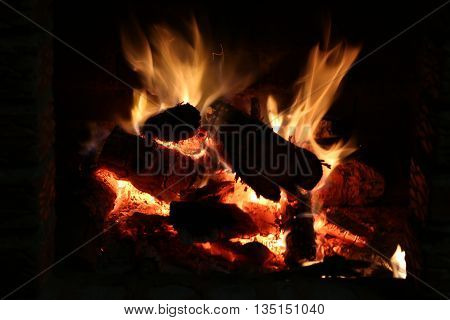 Fire at a hearth at a cottage.