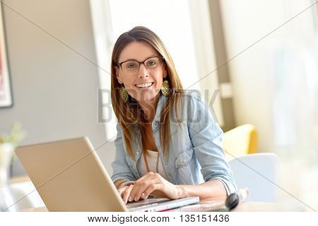 Trendy businesswoman working from home office