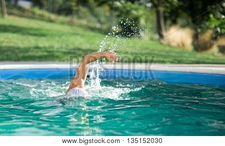swimmer recreating on outdoor pool