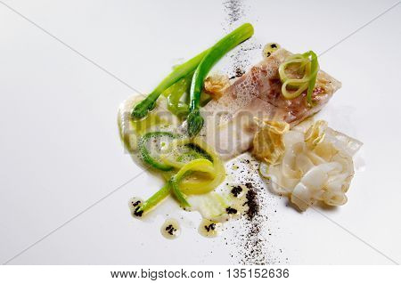 seabass fillet  with mixed vegetables and  frothy sauce