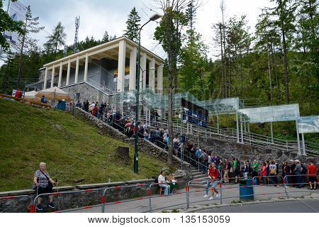 Kuznice Poland - June 15 2016: Long queue at Kasprowy cable car station in Kuznice nearby zakopane in Poland. Unidentified people visible.