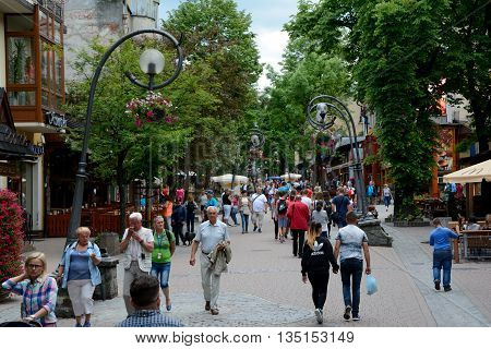 Zakopane Poland - June 15 2016: Krupowki street in Zakopane in Poland. Unidentified people visible.