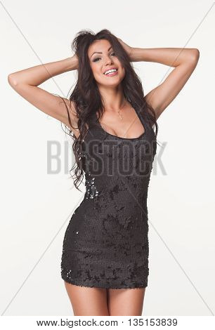 Fashion photo of beautiful brunette woman in black summer jumpsuit. Shopping mall. Sales and discounts concept. Hot girl.