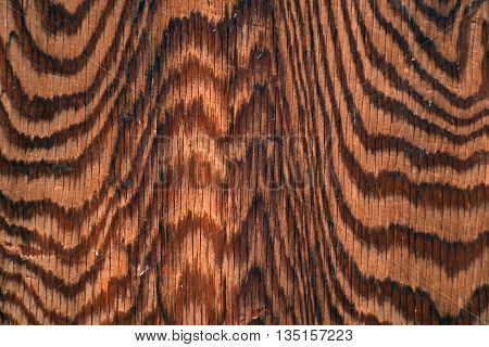 Unique abstract wood grain pattern in stained wood.