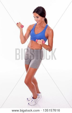 Brunette Woman Exercising With Pink Weights