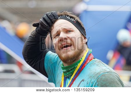 STOCKHOLM SWEDEN - MAY 14 2016: Man with mud in the face after finishing a race in the obstacle race Tough Viking Event in Sweden May 14 2016