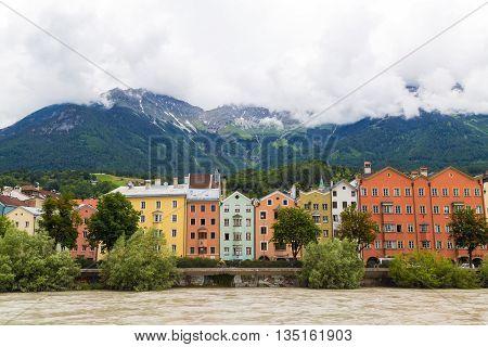 INNSBRUCK AUSTRIA - 18TH JUNE 2016: Colourful buildings along the side of the River Inn in Innsbruck during the day