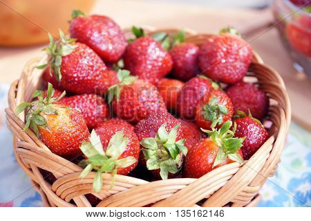 Bright fresh strawberry on a table in a round container