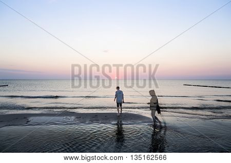 Double Exposure, Evening Walk At The Beach
