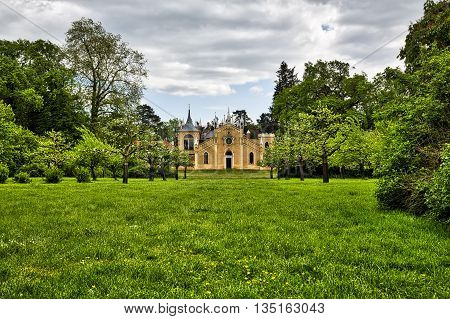 Woerlitzer Park: gothic house with garden and cloudscape
