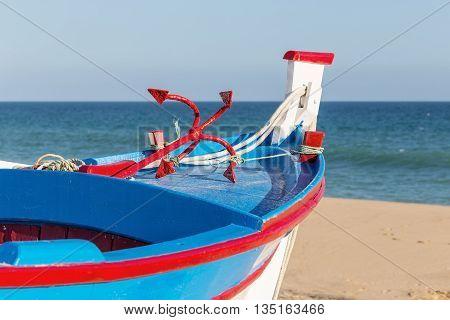 Traditional Portuguese boat on the beach. In Armacao de Pera.