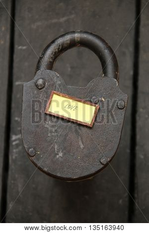 Love text and old padlock, Love relationship married or valentine idea.