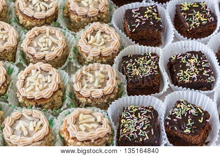 Chocolate and hazelnut cakes closeup. On birthday.