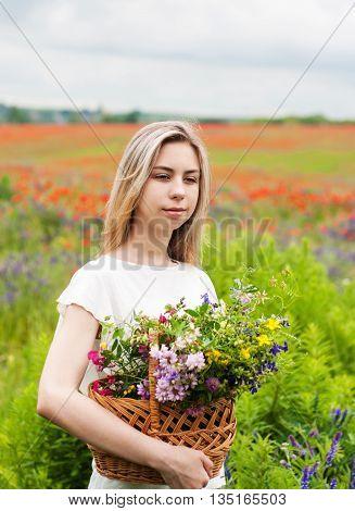 Beautiful Blonde Girl With Basket Of Wildflowers