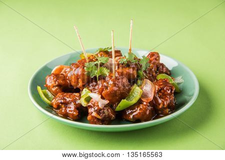 indian starter menu - Crispy Veg dipped in red sauce with onion and capsicum, vegetables with corn flour coating deep fried till it becomes crispy,famous Indian-Chinese starter menu