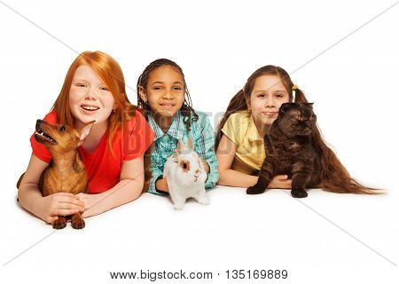 Happy three girls and their different pets playing together isolated on white