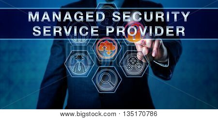 Male business manager is pushing MANAGED SECURITY SERVICE PROVIDER on an interactive control screen. Business metaphor and internet security concept for outsourced network security management.