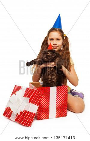 Little girl got a perfect present big black cat on her birthday isolated on white