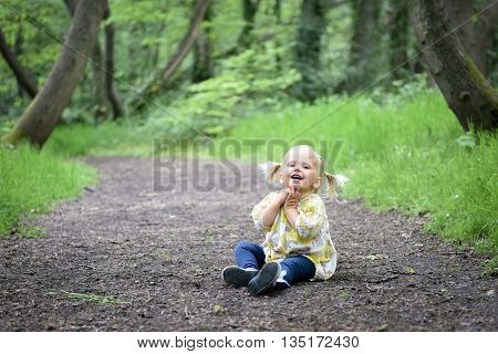 Happy Little Girl In The Wood