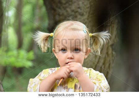 Portrait Of Cute Little Girl In The Park