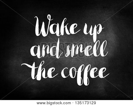 Wake up and smell the coffee written on a chalkboard