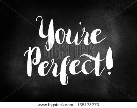 You're perfect written on a blackboard