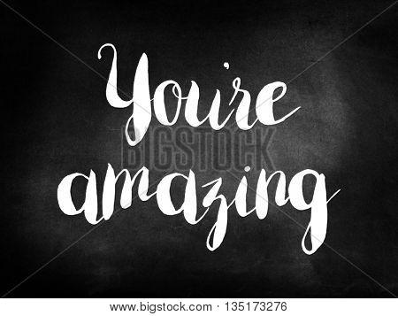 You're amazing written on a blackboard