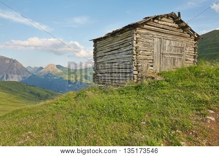 Hut made of logs in the mountains