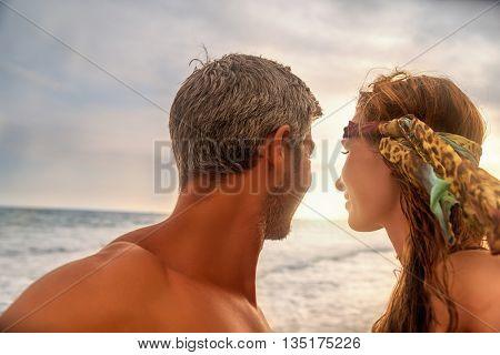couple backlit sky looking away