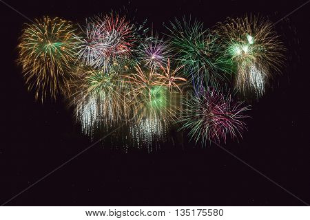 Beautiful celebration golden green sparkling fireworks. Independence Day 4th of July holidays salute. New Year beautiful fireworks. Holidays symbol background.